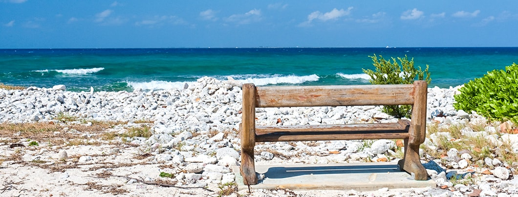 cayman brac beach bench 1060x403 min