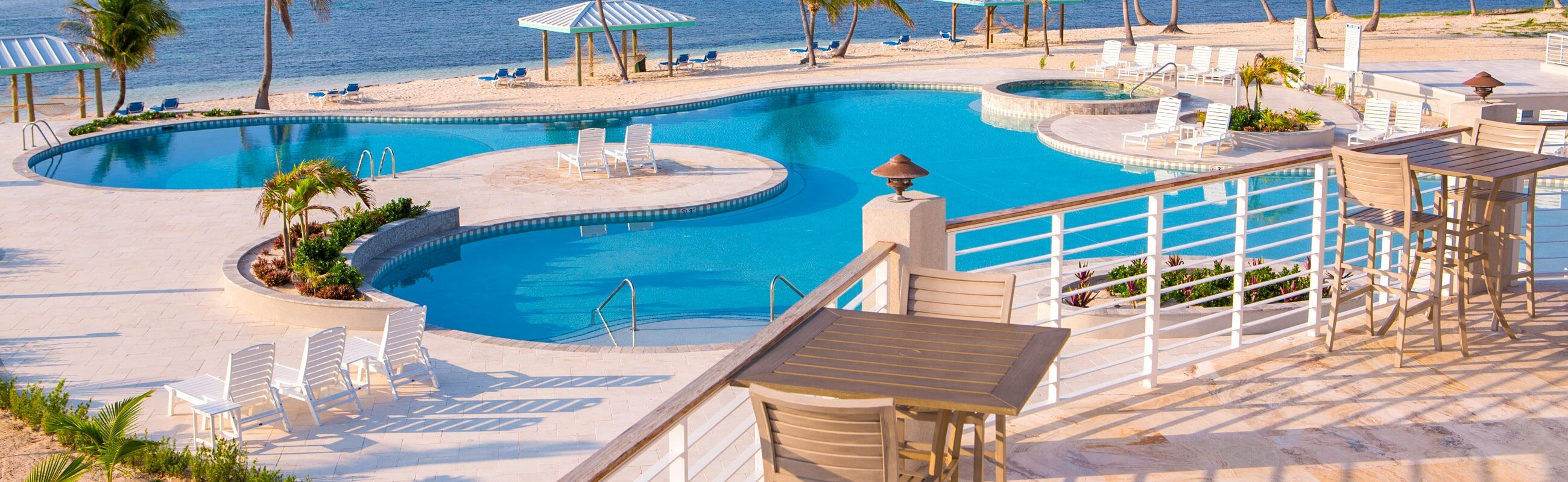 Water delights for everyone – our Caribbean beach with hammocks or our walk-in pool and jetted hot tub