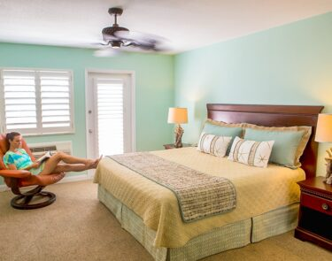 cayman brac bedroom woman reading1060x834 min