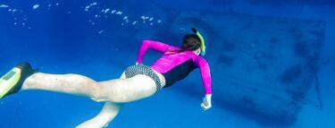 cayman brac girl snorkling over wreck 1060x403 min