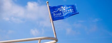 cayman brac reef divers flag 1060x403 min
