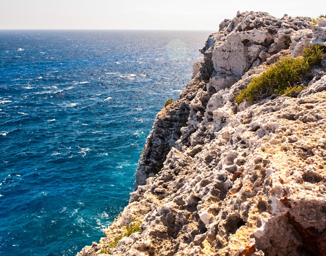 cayman brac rocky cliff water 1060x834 min